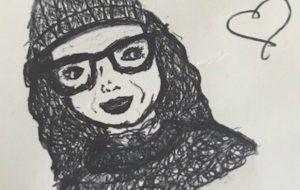 My daughter drew this picture of me. I am wearing a beanie and a jumper that my mum knitted.