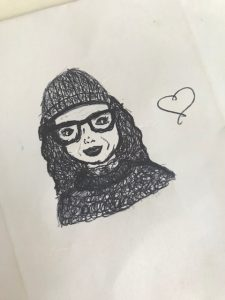 This is the picture my daughter drew of me wearing a beanie and a jumper my mum knitted